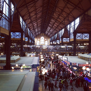 Inside the food hall.  Groceries are on the ground floor, eating places and touristy stands on the upper level.