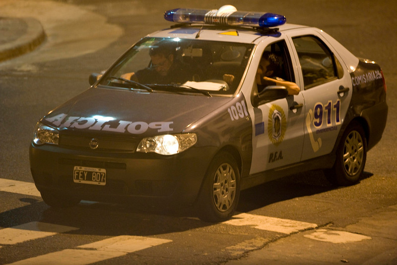 Photographing the police car, at ngiht with my telephoto lens.  Amazing, it was across the street amost 50 yards away.