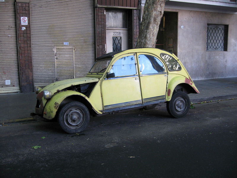"""This is an old Citroen car assumed to be someone's transportation.  This is what you really call, """"driving until the wheels fall off"""".  This is pretty common here to find cars in this condition."""