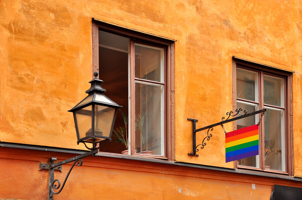 The Rainbow Flag and Wall Lamp in Stockholm Old Town, Sweden