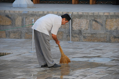 Hard at work, cleaning the forecourt at the Bakhouddin Nakshbandi mosque.