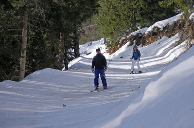 While Mrs got on with skiing, I took a walk up towards the mountains. The track was also a piste.