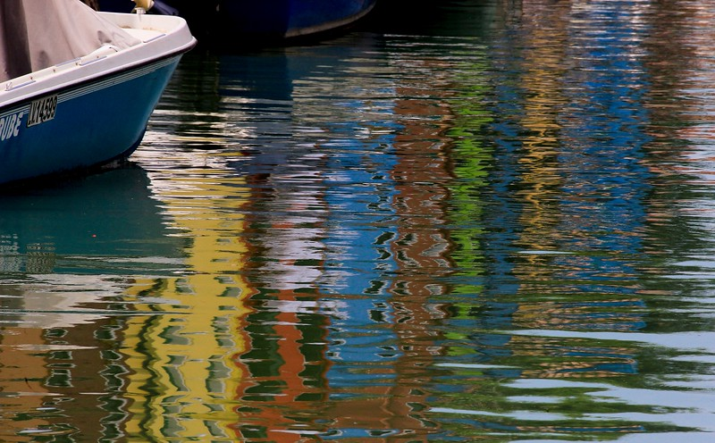 During my 4 hour stay I went down every canal of this small village looking for bright house color combinations and their associated reflections.