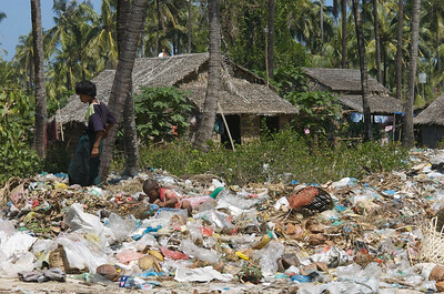 Burmese kids participating in the global economy, eeking out a living at the dump near Chaung Tha beach.