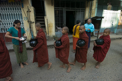 Young monks with their alms bowls on their morning rounds. The kids are pretty bored. They'll be out of the Sangha (monkhood) by the time they're 15 or so. Most of them, anyway.