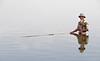 Fisherman near U Bein wooden bridge - he had no pants on...