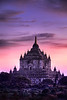 Early morning sunrise image of Thatbyinnyu Temple built in the year 1144.  Taken from Minyeingone temple. There is a jeweled vane at the top and it is the highest structure in Bagan.