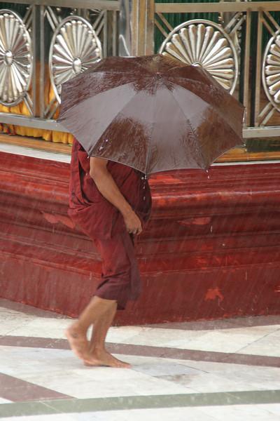 Monk at the Shwedagon Pagoda, Yangon on a rainy day