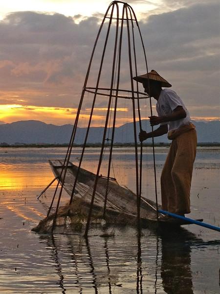 A random fish boat blocking a perfect sunset