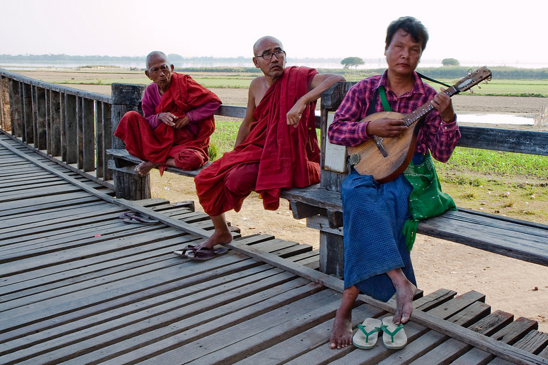 Monks and blind musician at U Bein Bridge, Amarapura