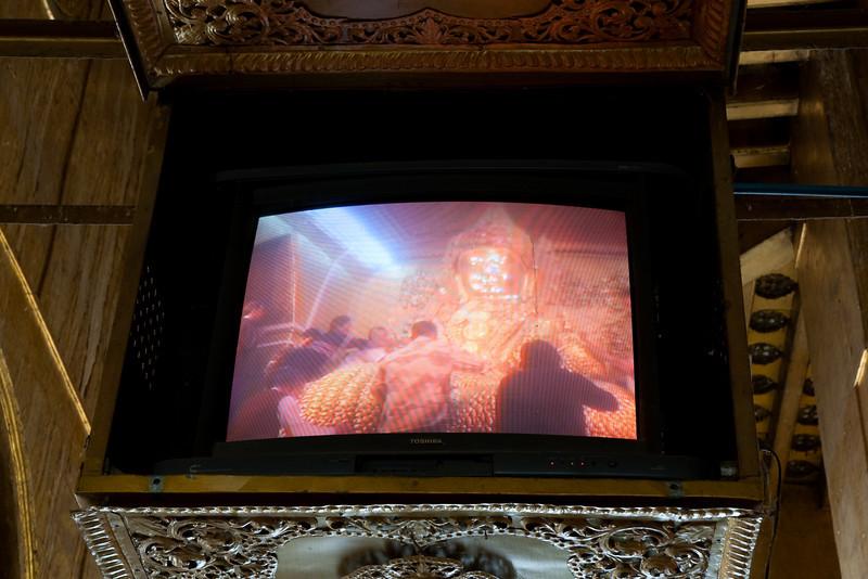 Mahamuni Buddha on of the many television screens at Mahamuni Paya, Mandalay
