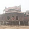 Shwe Yaunghwe Kyaung covered in early morning fog, Nyaungshwe