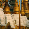 It is surrounded by hundreds of smaller stupas.