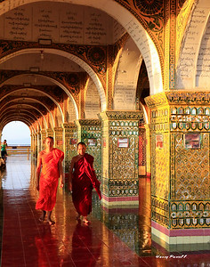 Monks at the hilltop temple in Mandalay.