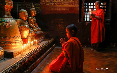 young monks in prayer