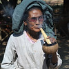 Enjoying a cheroot in Minnanthu village, Bagan, Burma