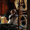Spinning Lotus thread in stilt village on Lake Inle, Burma.