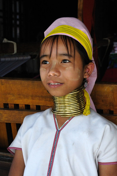Young girl of Padaung tribe -  her neck elongation has begun its long journey