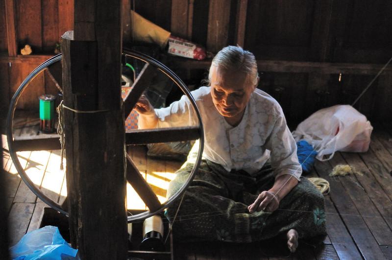 Spinning Lotus thread in stilt village on Lake Inle
