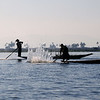 Fishermen frapping the water to stir fish