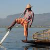 A leg-rower fisherman with his fish trap, Lake Inle, Burma.