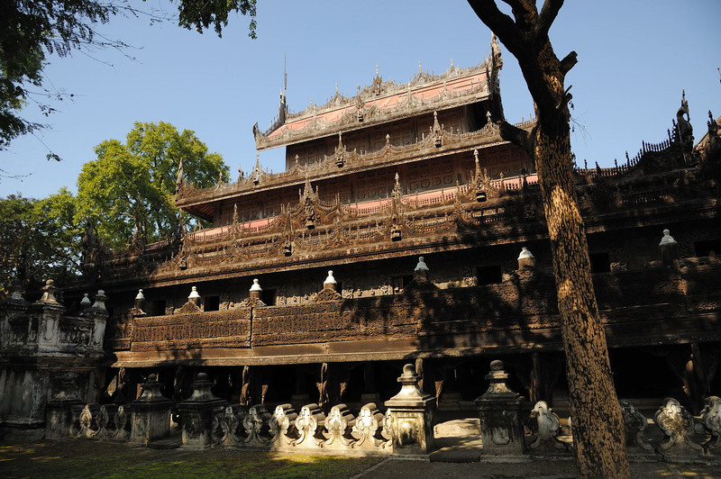 "<p align=""left"">Shwe Nandaw Kyaung - The Golden Palace, one of few original buildings of the Royal Palace remaining intact. King Mindon died in the Shwe Nandaw Kyaung. After the King's death, his son and successor Thibaw moved the building to its present location. It is almost entirely constructed of intricately carved teak, and was once completely gilded inside and out, as was almost all of King Mindon's Golden City. The outer guilding is now mostly washed away, and the untreated teak is darkly tanned by the sun but, much of the gilding still remains inside.</p>"