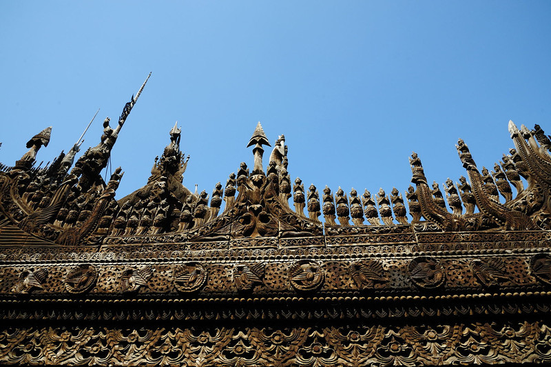 Intricate teak carvings on exterior of Shwe Nandaw Kyaung