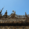 Intricate teak carvings on exterior of Shwe Nandaw Kyaung