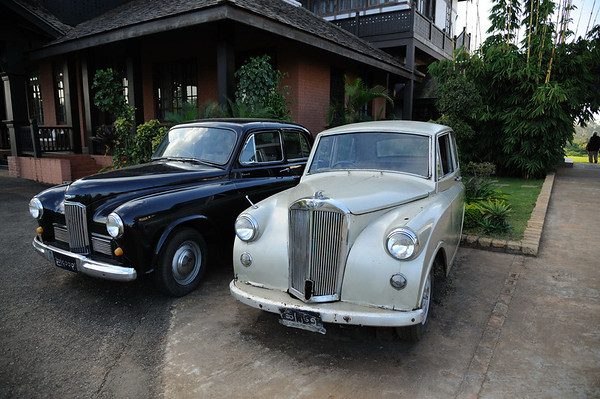 Parked outside the former British Governor's residence are a 1956 Mark VI Humber Hawk and a 1950 Triumph Mayflower.  They appeared to be almost in running condition.