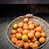 Orange seller at Kalaw train station, Burma