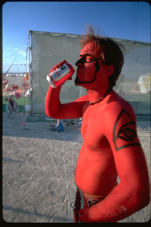 Red human drinks beer