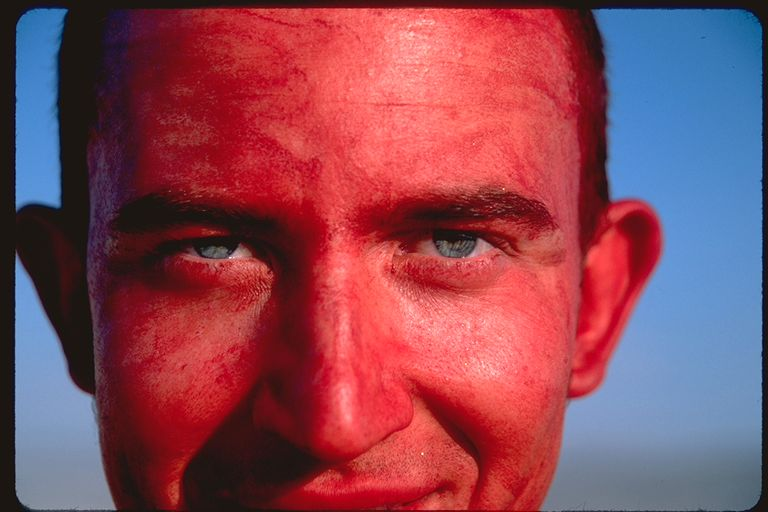 Red face green eyes