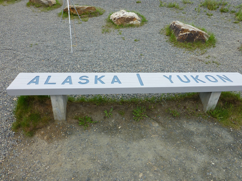 The dividing line between Alaska and Yukon...on a bench no less...well..