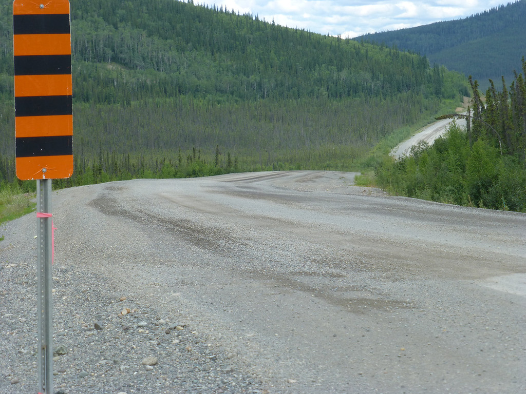 ....and off the pavement onto this greasy, wet downhill slime run...a farewell fuck you from Yukon...and this after 140 miles of the worst paved road I've ever ridden....this is what leads up to the border crossing into Alaska...