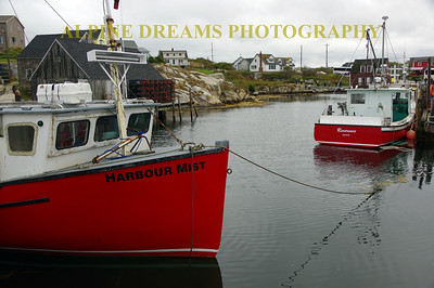 RED BOATS AT REST IN PEGGYS COVE