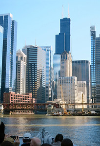 "22-Lake Street Bridge. The beige building behind the yellow crane and ""in front"" of the Willis Tower is the Chicago Civic Opera House. Boeing Building at far right."