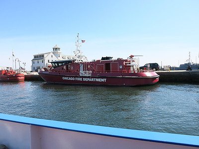 8-Chicago Fire has three boats. River meets Lake Michigan to the left of this photo.