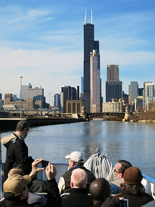 29-Heading north on the south branch of the river. Willis tower and 311 S. Wacker dead center.