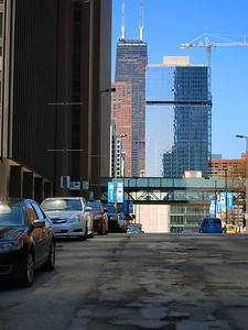 10-On Stetson Av looking north at Hyatt West Tower (far left in deep shadow) and bridge to East Tower. Hancock Bldg in distance (1969, 1127 feet).