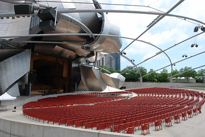 Jay Pritzker Pavilion and the Great Lawn The Jay Pritzker Pavilion and the Great Lawn is located at the east side of Millennium Park and comprises almost half the park. It is a 95,000 square-foot outdoor concert area with 4,000 fixed seats, plus the lawn area that can hold another 7,000 guests. Above the lawn is a steel trellis that distributes speakers throughout the entire lawn area, creating a truly modern acoustical environment.