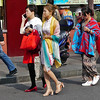 Ladies are dressed mostly in western style with chinese variations - very colourful clothing,  shiny shoes and jewellery with a lot of make-up.