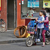 Two, three children with bag and baggage on scooters and cycles = a common sight on the streets