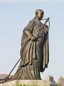 Bronze  statue of Xuanzang in front of the Wild Goose Pagoda