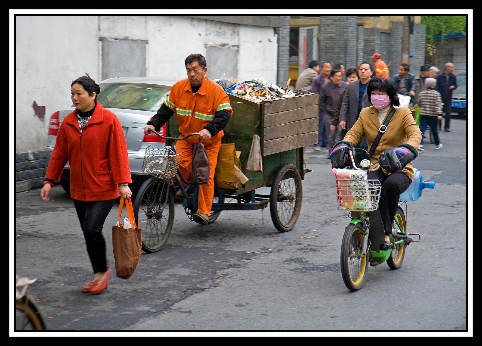 IMAGE: https://photos.smugmug.com/Travel/CHINA-FOCUS-TOUR-2010-GUILIN/i-6zJbKWf/0/5fce45d6/X3/Early%20morning%20alley%20traffic...-X3.jpg
