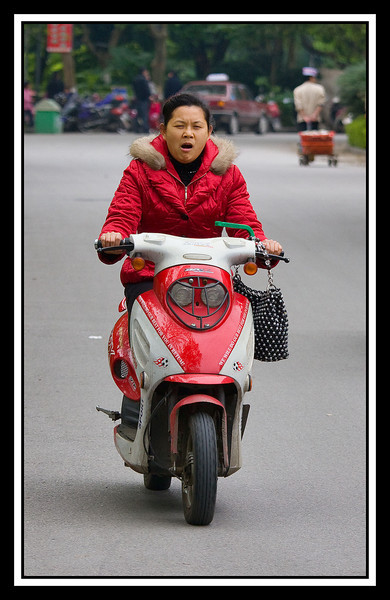 Riding motorscooter, Guilin...