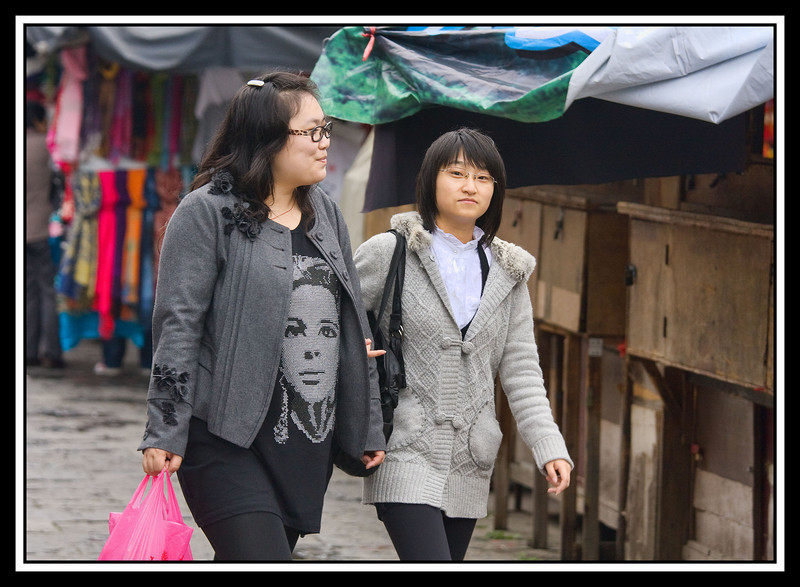 Girls walking in market, Guilin...
