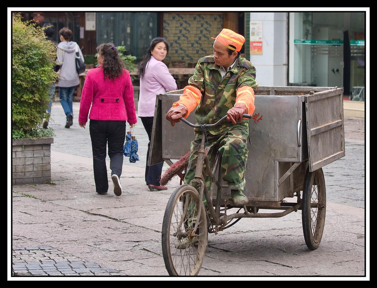 IMAGE: https://photos.smugmug.com/Travel/CHINA-FOCUS-TOUR-2010-GUILIN/i-bRXQnVm/0/45621167/X2/Guilin%20-%20Trash%20guy%20on%20three%20wheel%20bike-X2.jpg
