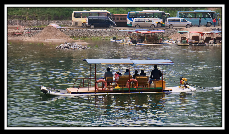 Outboard propelled bamboo tour raft...