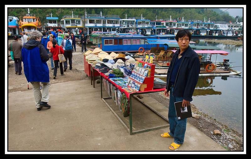 """Hello Guy"" vendors at boarding point."