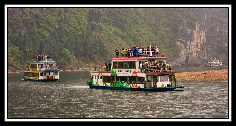 Tour boats rounding bend in river...